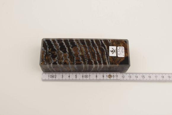 Brown-black mammoth molar block